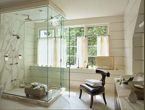 calacatta marble shower in a white mater bathroom by Jeffrey Bilhuber - via Atticmag