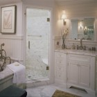 carrara bathroom with white cabinetry - Pineapple House via Atticmag