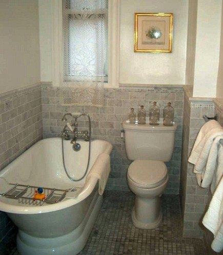 gray marble bathroom - classic gray tiled NYC apartment bathroom renovation - Atticmag