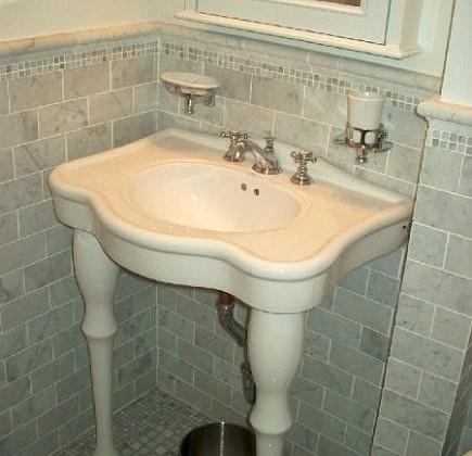 gray marble bathroom - classic gray tiled NYC apartment bathroom renovation - Atticmag