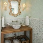 tiled wall traditional powder room with vessel sink of open table, mirror and sconces - via Atticmag