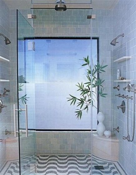 wet rooms - luxury home spa shower with shelving, multi showers heads and window - Elle Décor via Atticmag