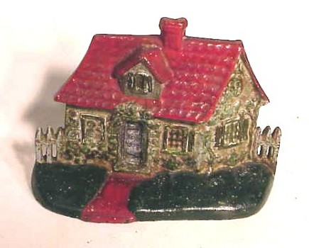 vintage cottage doorstop with red tile roof - Atticmag