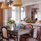 lattice walls - white trellis over mirror walls in a dining room Allison Caccona - House Beautiful via Atticmag
