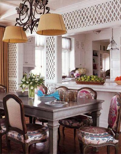 lattice walls - white trellis over mirror walls in a dining room Allison Caccona - House Beautiful via Atticmag
