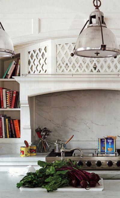 lattice walls - mirrored lattice detail on a custom range niche in a kitchen by Allison Cacconoa - House Beautiful via Atticmag