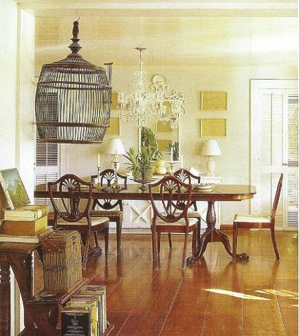 Dining room with picture wall at India Hicks house, Hibiscus Hill - Array via Atticmag