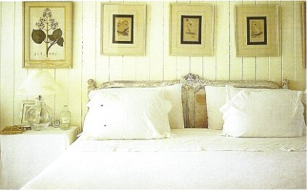 Guest room picture wall in India Hicks house Hibiscus Hill - Array via Atticmag