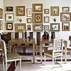 corner picture walls - with traditional and modern mix over a two-wall banquette - Elle Décor via Atticmag