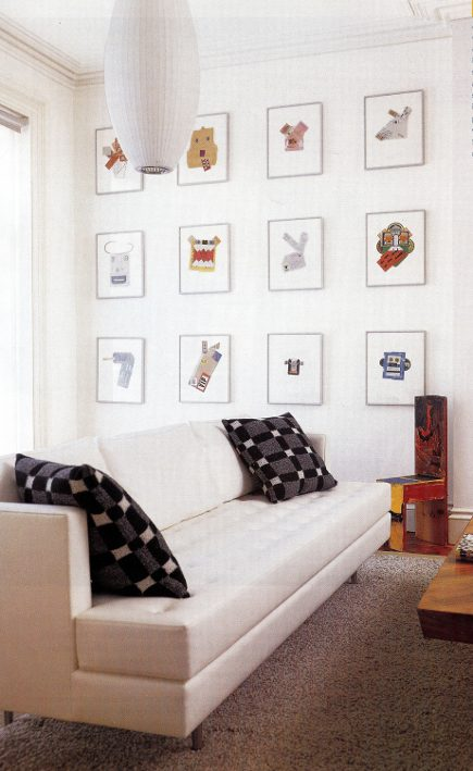 pictue walls - collages spaced well apart to occupy an entire living room wall in 3 rows of 4 images - Met Home via Atticmag