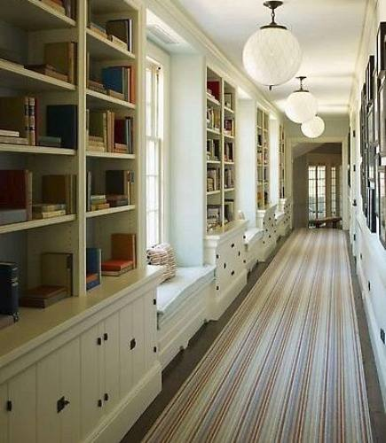 hallway rugs - bookcase lined hallway with striped runner by SR Gambrel via Atticmag