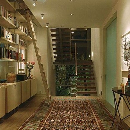 hallway rugs - oriental rug in hallway from Charlie Barnett and Assoc via Atticmag