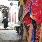 rugs in Morocco - Kilims hanging in the souq at Fez - Atticmag