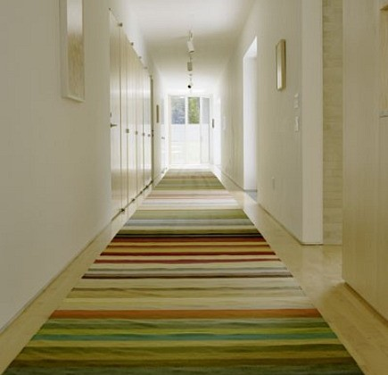 hallway rugs - colorful striped hallway runner from Hanrahan Meyers Architects via Atticmag