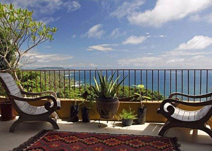 kilim rugs - ocean view balcony in Costa Rica with kilim rug - Mariposas del Sol via Atticmag