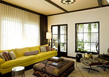kilim rugs - Kilim covered living room ottoman - via Atticmag