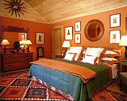 kilim rug - colorful Kilim in bedroom designer Bunny Williams via Atticmag