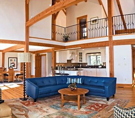 one rug, two room views - view number one: post and beam living room with modern rug from Landry and Arcari via Atticmag