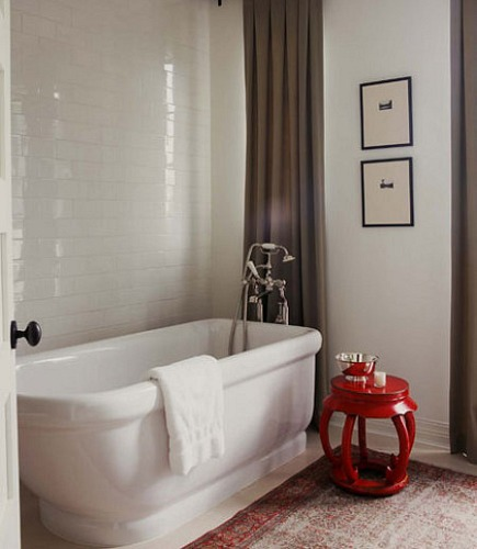 rugs in bathrooms - oriental rug in bathroom by freestanding tub from Burnham Design via Atticmag