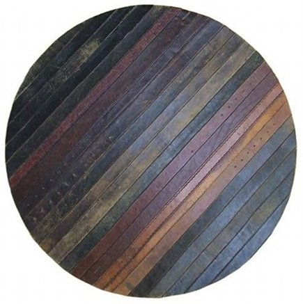 recycled rugs - vintage leather belts are upcycled into modern area rugs - branch home via Atticmag