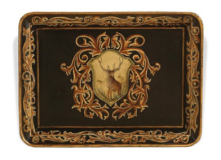 tray with black and gold accents and a deer medallion - Nell Hills via Atticmag