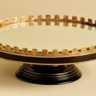 black and gold accents mirrored serving cake stand - Nell Hills via Atticmag