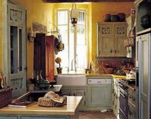 blue rooster motif Mark Wilkinson French provincial kitchen with yellow walls - mfw via Atticmag
