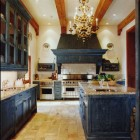 indigo cabinet kitchen - large scale kitchen with indigo cabinets, giant range hood and Venetian chandelier by Bunny Williams via Atticmag