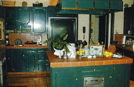 Hollywood legend kitchen - kitchen prior to renovation in a house once owned by Errol Flynn - via Atticmag