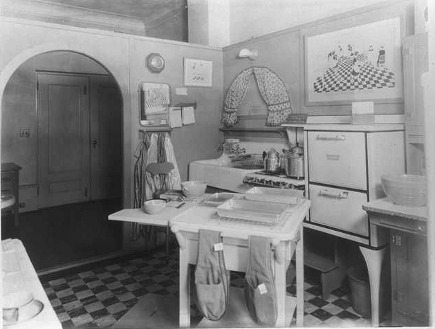 kitchens 1920-2010 - unfitted kitchen in the The Kitchen Practical 1929 via Atticmag