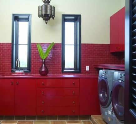 red laundry room - Moroccan red tile and cabinet laundry room Tracery Interiors - via Atticmag