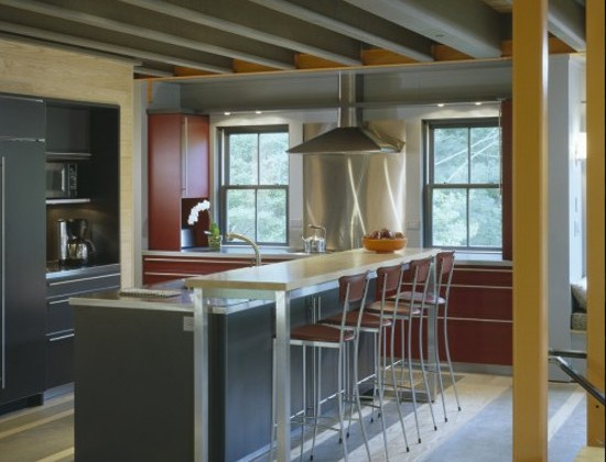 maroon accent in a modern gray kitchen by Hutker Architects via Atticmag