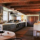 stone kitchen - John Saladino restored stone kitchen with stainless steel cabinets - Saladino Style via Atticmag