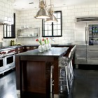 Wolf appliances in a modern white-tile and cherry cabinet coffee-color kitchen - hammersmith.net via Atticmag