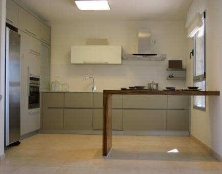 neutral contemporary kitchens - minimalist kitchen with taupe base cabinets and cantilevered wood counter - via Atticmag
