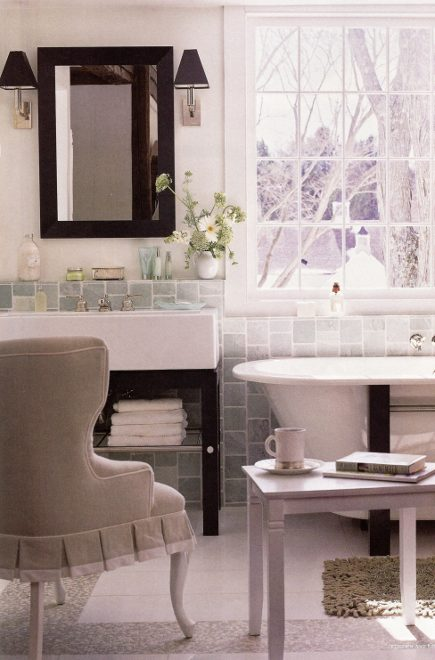 modern washstand and matching tub in a combination master bedroom and bathroom - Kitchen and Bath Ideas via Atticmag