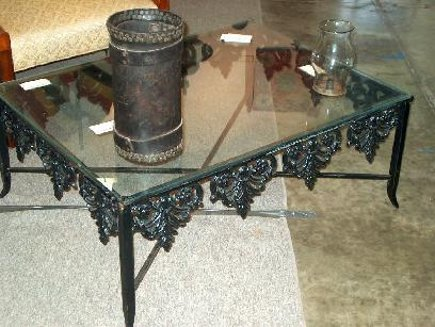 metal base tables- black wrought iron cocktail table with palmette motif frame - atticmag
