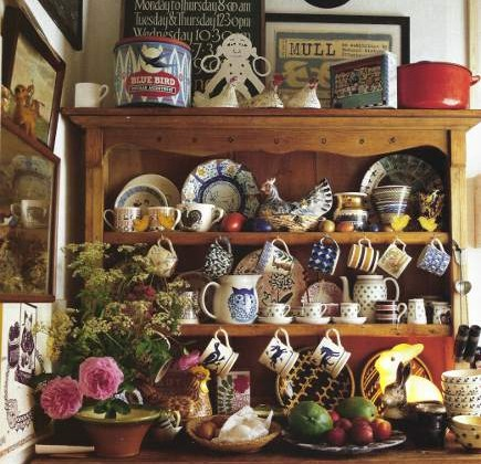 adishware display - antique English majolica plates and pitchers collection in a pine hutch - AD via Atticmag