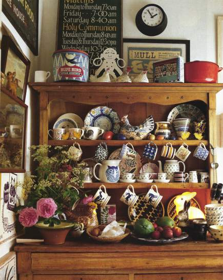 dishware display - antique pine hutch filled with animal motif dishes - AD via Atticmag