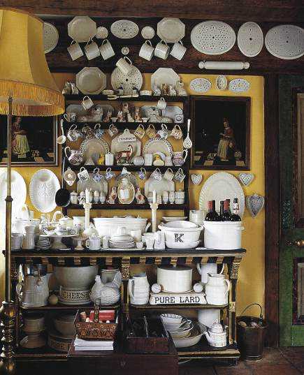 dishware display -English white ware including molds and mugs in an ebonized hutch - WOI via Atticmag