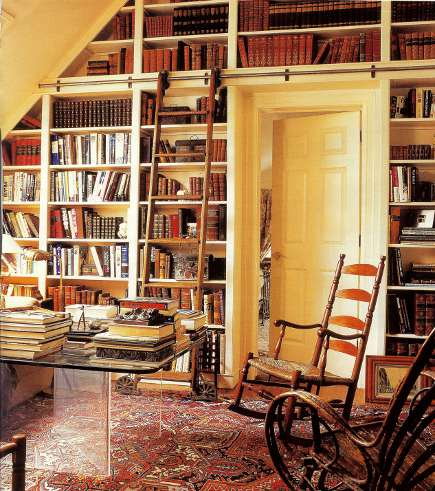 rolling library ladder in an East Hampton house - Domino via Atticmag