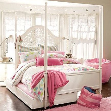 kids' rooms - white four poster bed with trundle and headboard with cut outs - Pottery Barn Teen via Atticmag