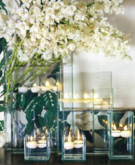 simple white Christmas flowers - white cymbidium orchids are cut and displayed a tall vase - Veranda via Atticmag