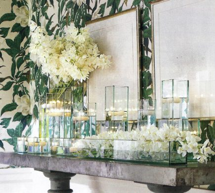 simple Christmas flowers - white cymbidium orchids displayed in tall and low vases on a dining room sideboard - Veranda via Atticmag