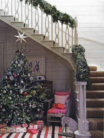 Christmas room - Christmas decorated foyer with a tree beneath the stairs - House & Garden via Atticmag