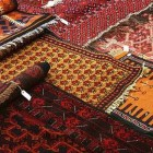 rug buyer's checklist - red and yellow oriental rugs - Atticmag