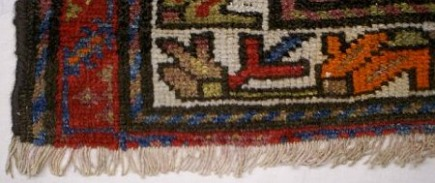 rug buyer's checklist - Rug is even at the fringe line, wefts are secured with a sewing repair - Atticmag