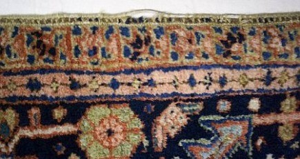 rug buyer's checklist - missing wool at the edge exposing outer warps on an oriental carpet - Atticmag