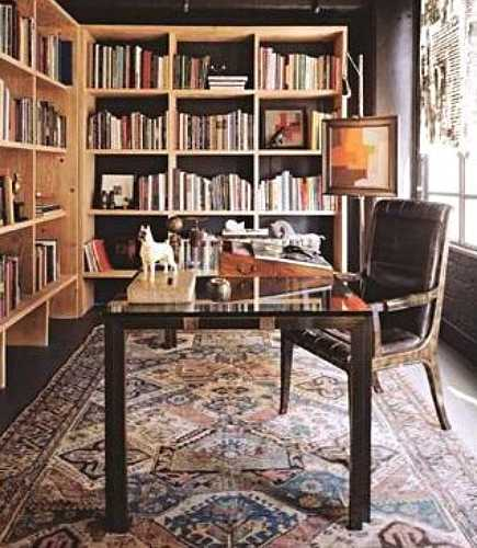 rugs in work spaces - desk on Persian rug in home office library from Goldberg Downey Architects via Atticmag