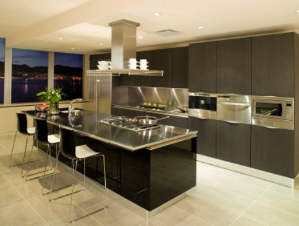 black lacquer kitchens - black and charcoal kitchen with stainless counters - via Atticmag